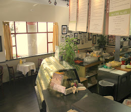"""Photo: The New New Deli has new gold curtains, tablecloths, and menu boards. (Plus a """"Wall of Fame"""" towards the back...)"""