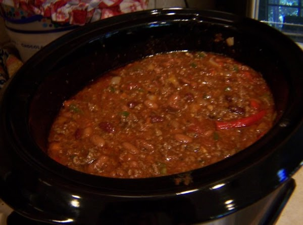 transfer to crock pot, add canned beans and simmer for 3 hours.