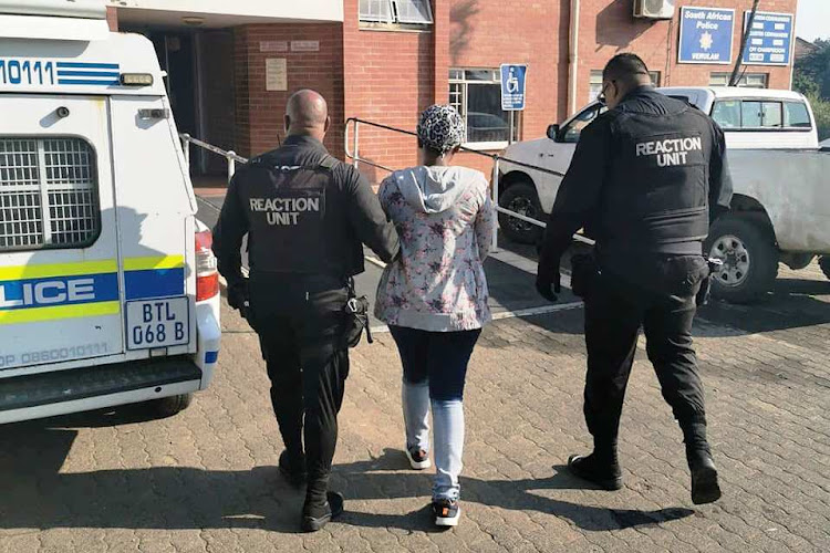 The 21-year-old woman accused of abandoning her baby is led into Verulam Police Station on July 14.