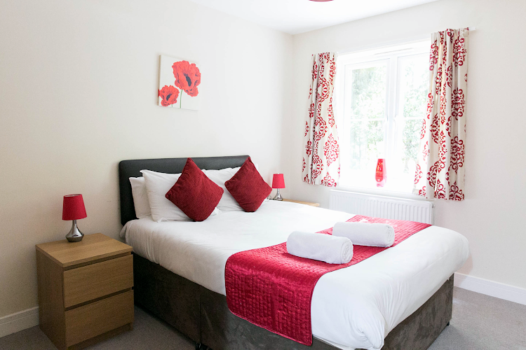 Luxury bedroom at Grove Cross Road Apartments