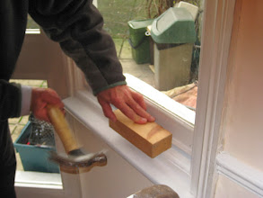 Photo: A hammer and block used to make sure that good contact is made, tape-to-frame