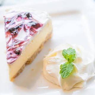 Traditional New York Style Cheesecake With Sour Cream Topping.