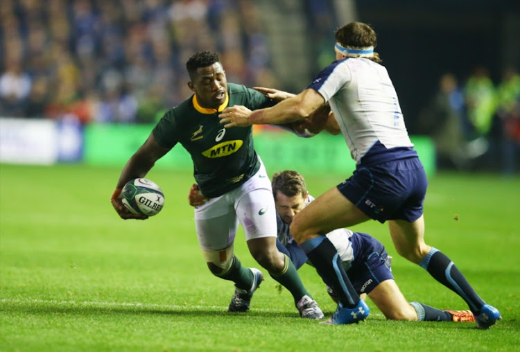 Siya Kolisi (captain) of South Africa tackled by Hamish Watson of Scotland during the Castle Lager Outgoing Tour match between Scotland and South Africa at BT Murrayfield on November 17, 2018 in Edinburgh, Scotland.