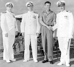 Photo: Capt. G.H. Duffy, RADM J.C. Clifton, Mayor George Spikes of Beeville and Capt. T.D. Harris at the change of command ceremonies July 15, 1958