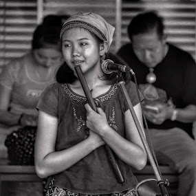 Street performer in Laos by Rick Pelletier - Novices Only Street & Candid