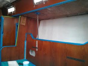 Photo: Pilot berth overhead, bulkhead, and interior of starboard salon lockers read for primer.