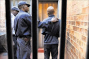 GOT YOU: Sergeant Vincent Nkuna with the suspect. The young man was arrested by Eldorado Park detectives on Tuesday. 16/04/09. Pic. Vathiswa Ruselo. © Sowetan.