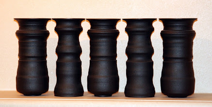 Photo: Ceramic vases by Greg Payce. It's all about the negative space -- look closely