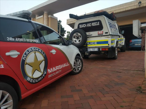 Police Search and Rescue Unit' as well as medics from Marshall Security, arrive at the home of the Umhlanga man who was electrocuted in his ceiling. Picture MARSHALL SECURITY