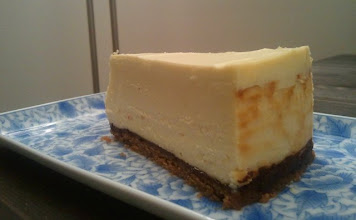 Photo: A wedge of London Cheesecake with dark chocolate brushed digestives base.