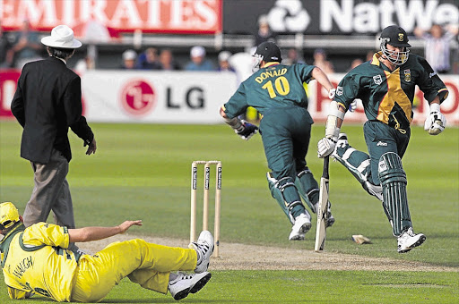 Proteas batsmen Lance Klusener, right, and Allan Donald meet at one end before the latter is run out in the World Cup semifinal against Australia at Edgbaston on June 17 1999 with the scores tied.