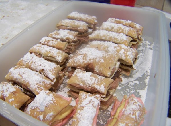 after you've assembled your pastries lightly dust with powdered sugar and refridgerate for a...