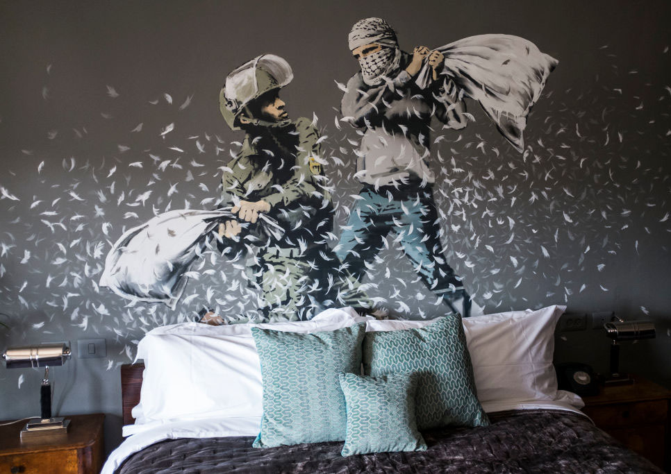 Banksy opens hotel in bethlehem overlooking israeli for Design hotel sauerland am kurhaus 6 8