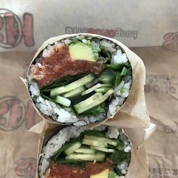 Nori and sushi rice wrap woth spicy tuna and veggies