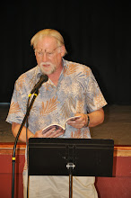 Photo: William Scott Galasso reads one of his poems.