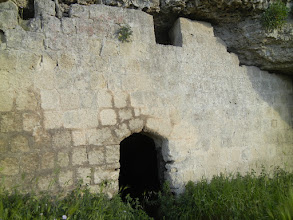 Photo: Cave dwelling entrance, cliff opposite Matera