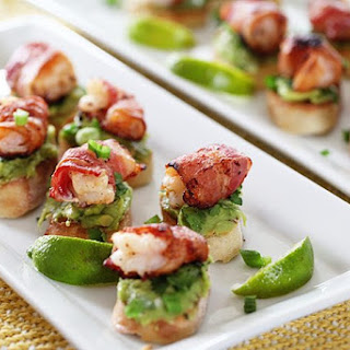 Bacon Wrapped Shrimp Appetizer With Avocado On Garlic Toast.