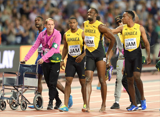 Usain Bolt (2nd R) of Jamaica pulls up during the Men's 4x100m Relay final during day nine of the 16th IAAF World Athletics Championships at the London Stadium on August 12, 2017 in London, United Kingdom.  (Photo by Karwai Tang/WireImage)