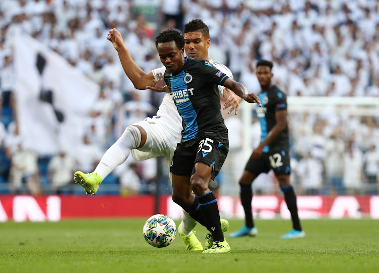 Club Brugge's Percy Tau in action with Real Madrid's Casemiro. Tau gave the Real defence a really tough time.
