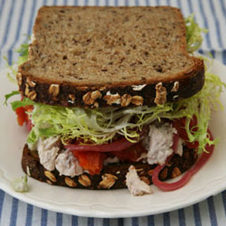 Chicken Salad, Walnuts, Roasted Tomatoes, Pickled Red Onions, and Frisée on Multigrain Bread.