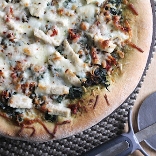 Pesto Chicken Pizza with Mascarpone, Spinach, and Sun-Dried Tomatoes