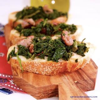 Broccoli Rabe, Sausage & Scamorza Affumicata Crostini.