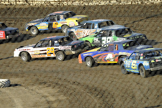 Photo: And there go the IMCA Stock Modified cars. I followed along in the program.