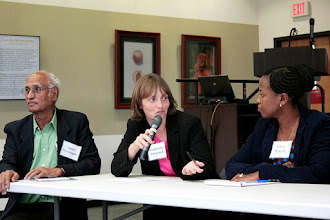 Photo: Stephanie Yarwood engages in conversation with others on the environmental stressors panel.