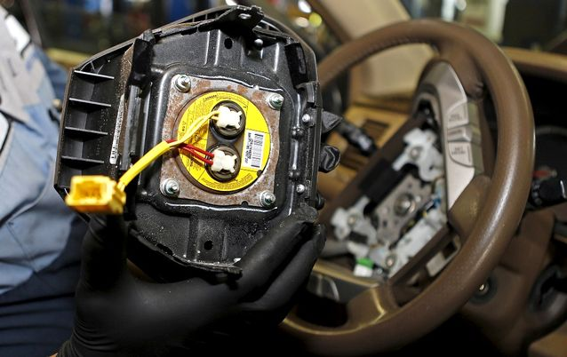 A technician holds a recalled Takata air bag inflator. Picture: REUTERS