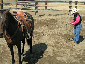 Photo: Here's a trick that helps keep the kinks out of your lariat as you coil-up, while the end is affixed to your horse...You will turn the entire set of coils over.