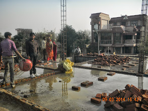 """Photo: After the Roof has been cast, one needs to build small brick """" munders"""" like this on the roof and do proper """"Tarai"""".. watering of the concrete poured...Nanak Builder did for 2 weeks, although per them one week was enough."""
