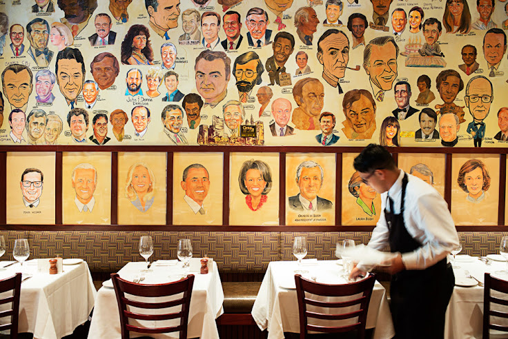 The portraits on the wall at The Palm.  Photo: Scott Suchman.