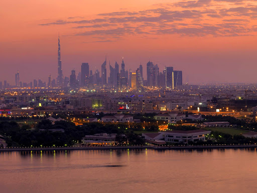 The cityscape of Dubai at sunset.