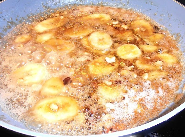 Melt butter in a large heated skillet.  Add remaining brown sugar to the...