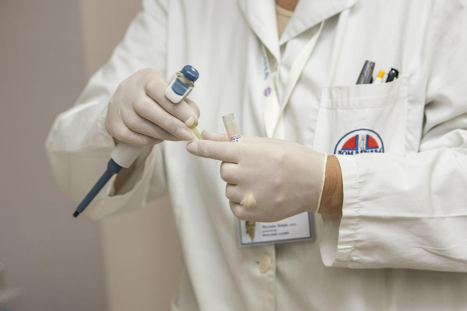 A medical professional handling hazardous materials