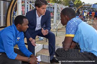 Photo: Coach McKinstry speaks with his assistant coaches at half time. [Rwanda vs Uganda, CECAFA 2015 Final, 5 Dec 2015 in Addis Ababa, Ethiopia.  Photo © Darren McKinstry 2015, www.XtraTimeSports.net]