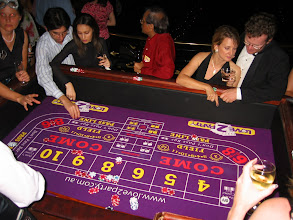 Photo: Craps table teaching guests a fun game
