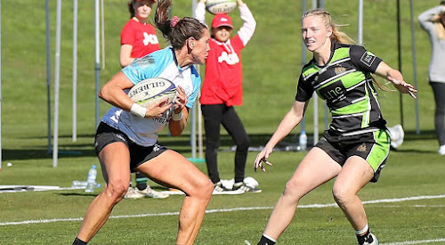 Lauren Nott, right, shapes to make a tackle against a University of Canberra player at the Aon Women's Uni Sevens Series' first round in Tasmania on Saturday.