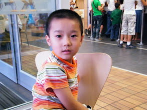 Photo: baby son, warrenzh, glad to be in KFC after his dad's return from his hometown.