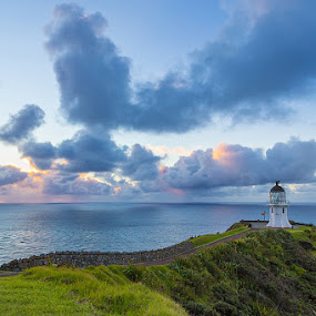 Cape Reinga at sunset by Mikey Mackinven - Landscapes Waterscapes ( walking, red sky, cape, travel, coastline, hiking, cape reinga, rough sea, tide, weather, non-urban, clouds, tasman sea, awe, majestic, elegance, lighthouse, pacific ocean, horizon, sea, scenic, rough, landmark, tourist, headland, horizontal, sunset, scene, rural scene, storm tide, horizon over water, north island,  )