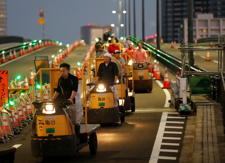 Workers drive vehicles known as Turret Truck to Toyosu market during a relocation from Tsukiji market in Tokyo, Japan, October 7 2018. Picture: REUTERS/KIM KYUNG-HOON