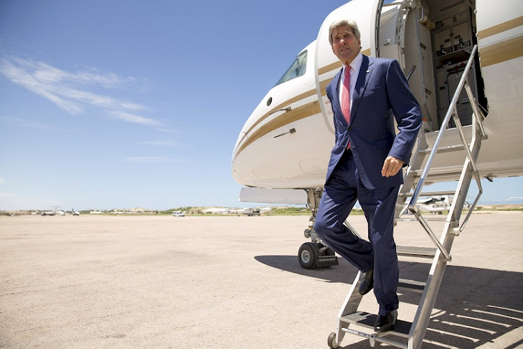 US Secretary of State John Kerry arrives at the airport in Mogadishu, Somalia, on Tuesday. Picture: REUTERS