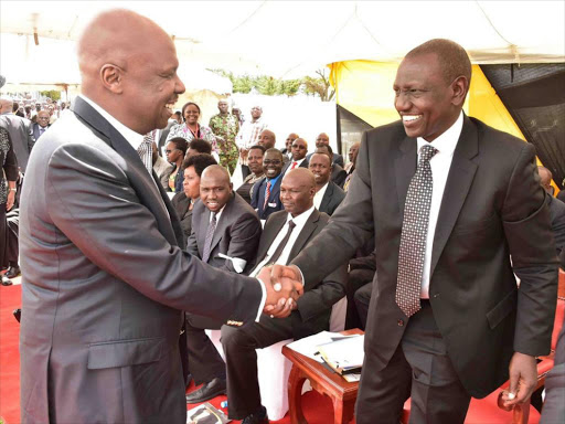 Baringo Senator Gideon Moi shakes hands with Deputy President William Ruto during the burial of Baringo South MP Grace Kipchoim on May 5, 2018.