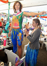 Photo: EUMUNDI, AUSTRALIA - MAY 15:  A Body Artist paints her model at the Australian Body Art Carnivale on May 15, 2010 in Eumundi, Australia.  (Photo by Bradley Kanaris/Getty Images)