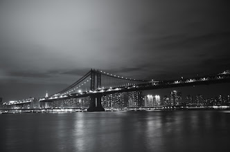 Photo: Manhattan Bridge - Night - New York City  The world stops spinning on its axis  as the city's lights search through the night  for hearts that flutter to the  syncopation of its pulsating lights.  —-   This was taken on a stormy night in Brooklyn with the Sony A99 as the waves in the East River pounded the piers and the wind whipped against the faces of the few brave souls who were still standing at the edge of Brooklyn Bridge Park hoping to catch a first glimpse of the city's lights as they flickered into view.  I am always amazed at the power of long exposure photography to calm the chaos in a landscape, especially in a cityscape.  ---  You can view this post with all relevant links over at my photography blog here:  http://nythroughthelens.com/post/51186388459/manhattan-bridge-night-new-york-city-the  ---  Tags: #photography   #nyc   #newyorkcity   #newyorkcityphotography   #cityphotography   #urban   #cityscape   #newyorkcityskyline   #blackandwhitephotography   #longexposurethursday