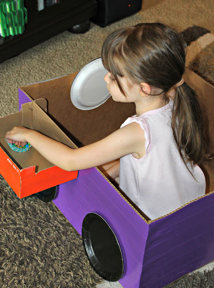 Make an easy DIY Cardboard Box Car for a fun drive in movie experience for your kids