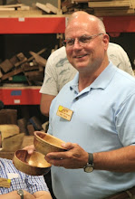 Photo: Joe Stout with his two Eastern red cedar bowls with different rim treatments.