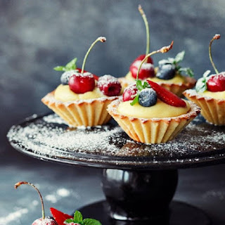 Fragile Muffins with Cream and Fruits