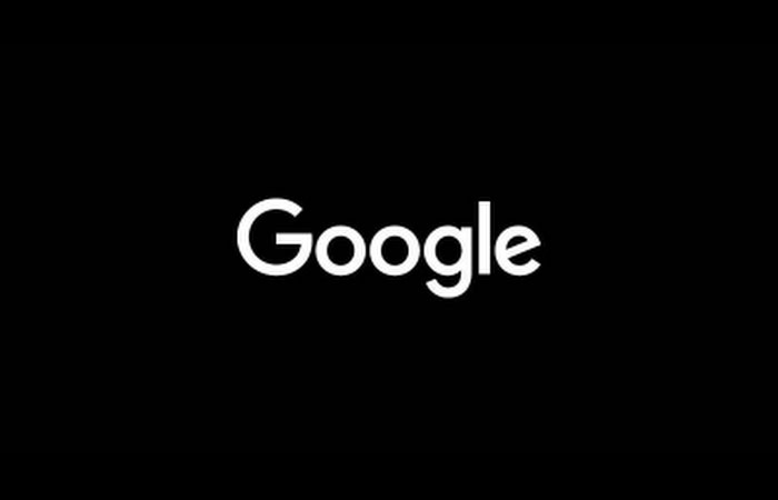 White Google logo on black background.