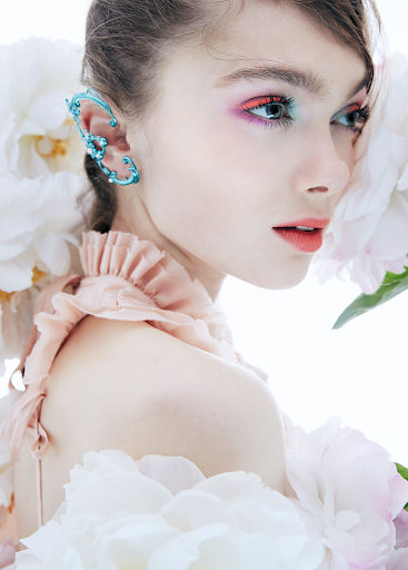 Beauty editorial featuring makeup products from Make Up For Ever, Estee Lauder and Aerin x Johanna Ortiz.